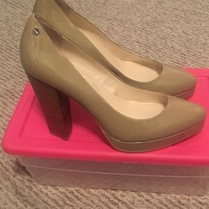 Calvin Klein platform heel with wooden heel.